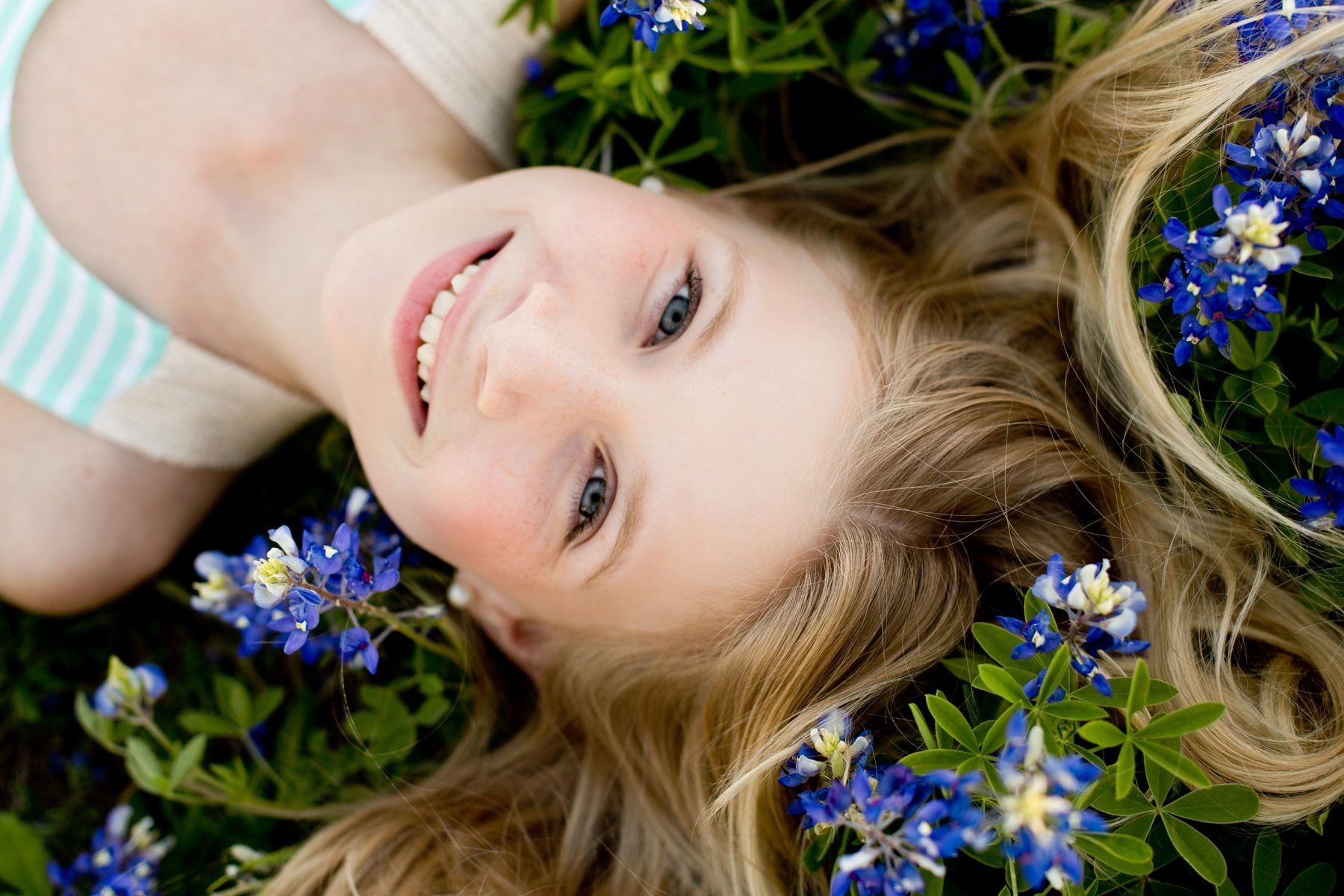11 year old girl laying down in bluebonnets - prosper, tx