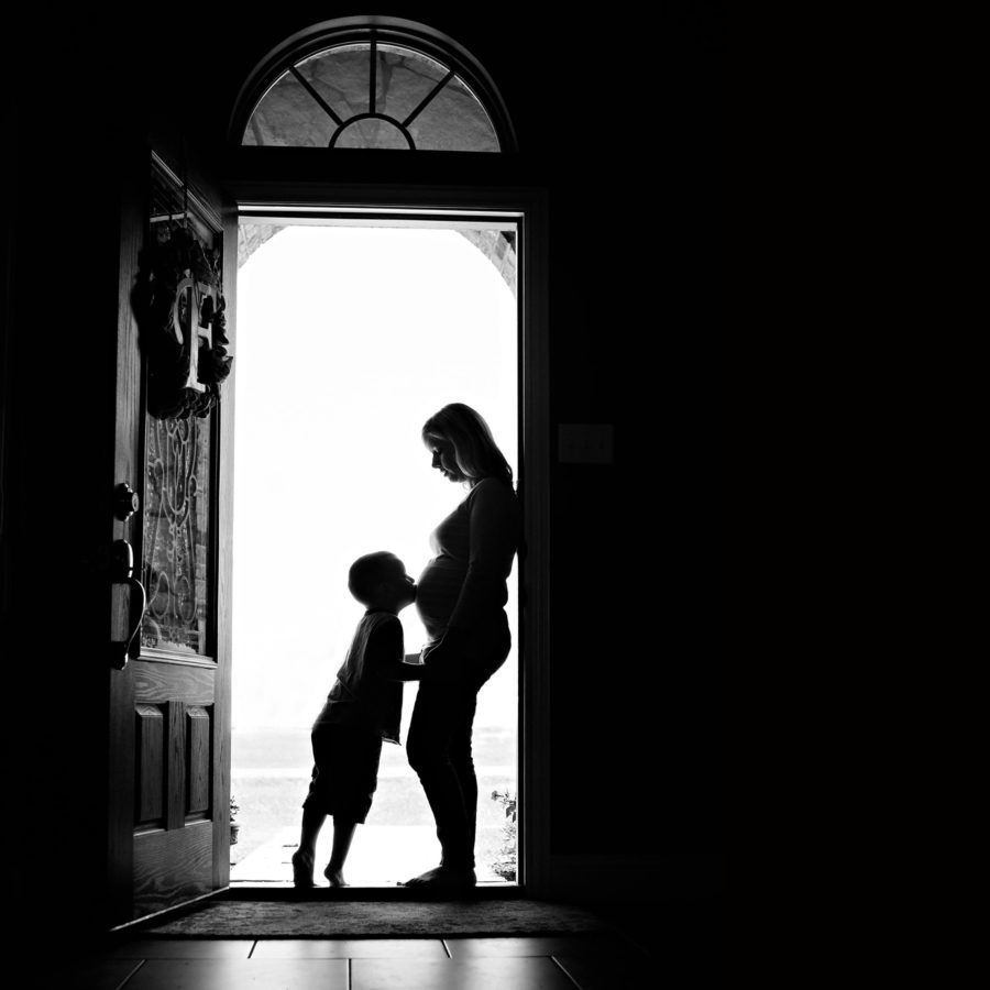 maternity silhouette of mom and little boy in home door - frisco, TX