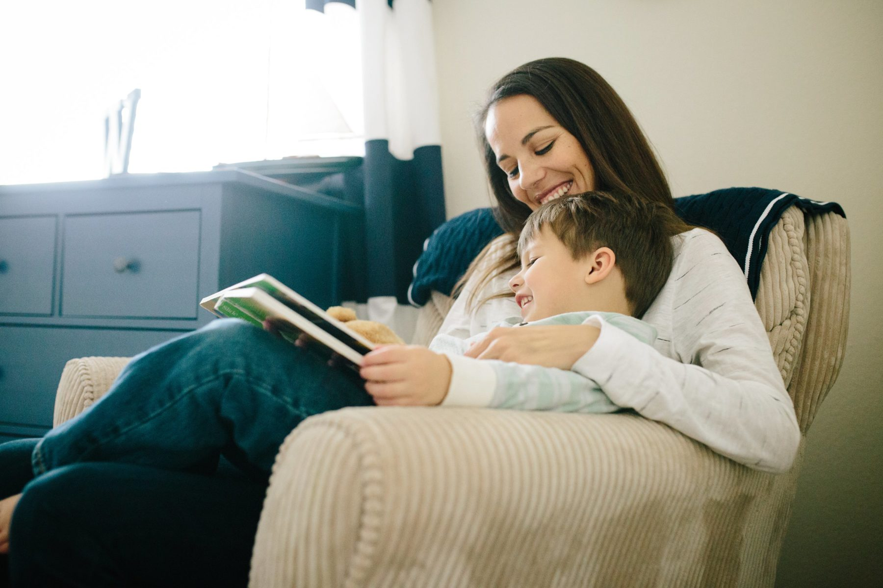 mom reading to toddler son - frisco family photography