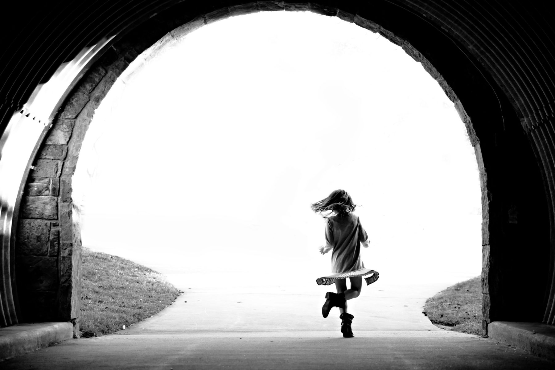 Silhouette of little girl dancing in tunnel | Adriatica McKinney