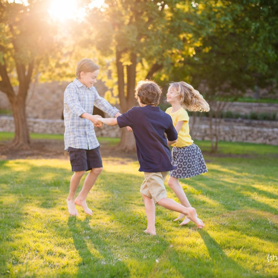 boy + girl twins and their older brother playing in the grass at sunset - frisco tx