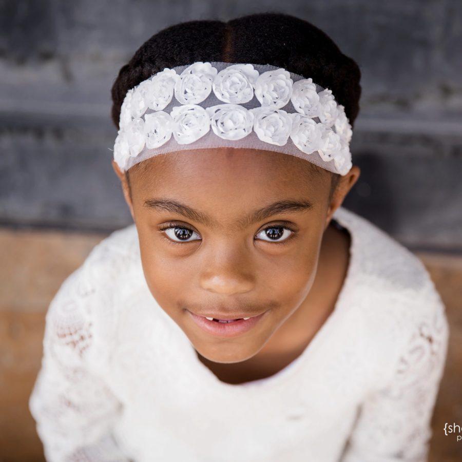 little girl in white dress portrait