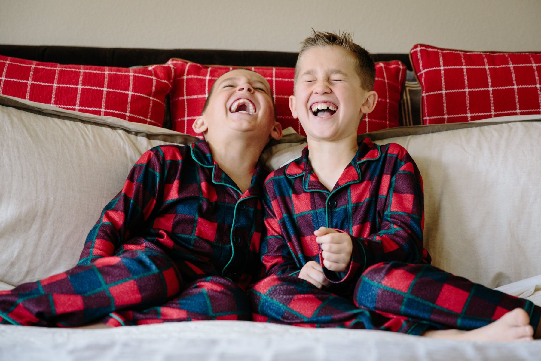 Boys laughing in flanel PJS