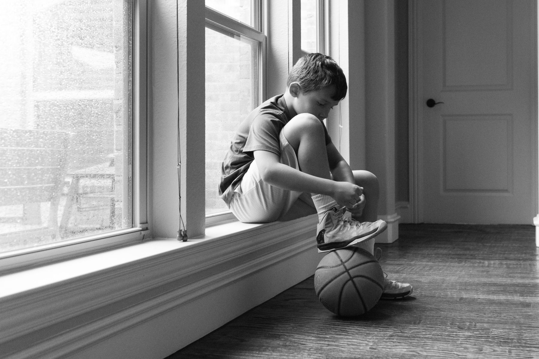 Boy tying basketball shoes