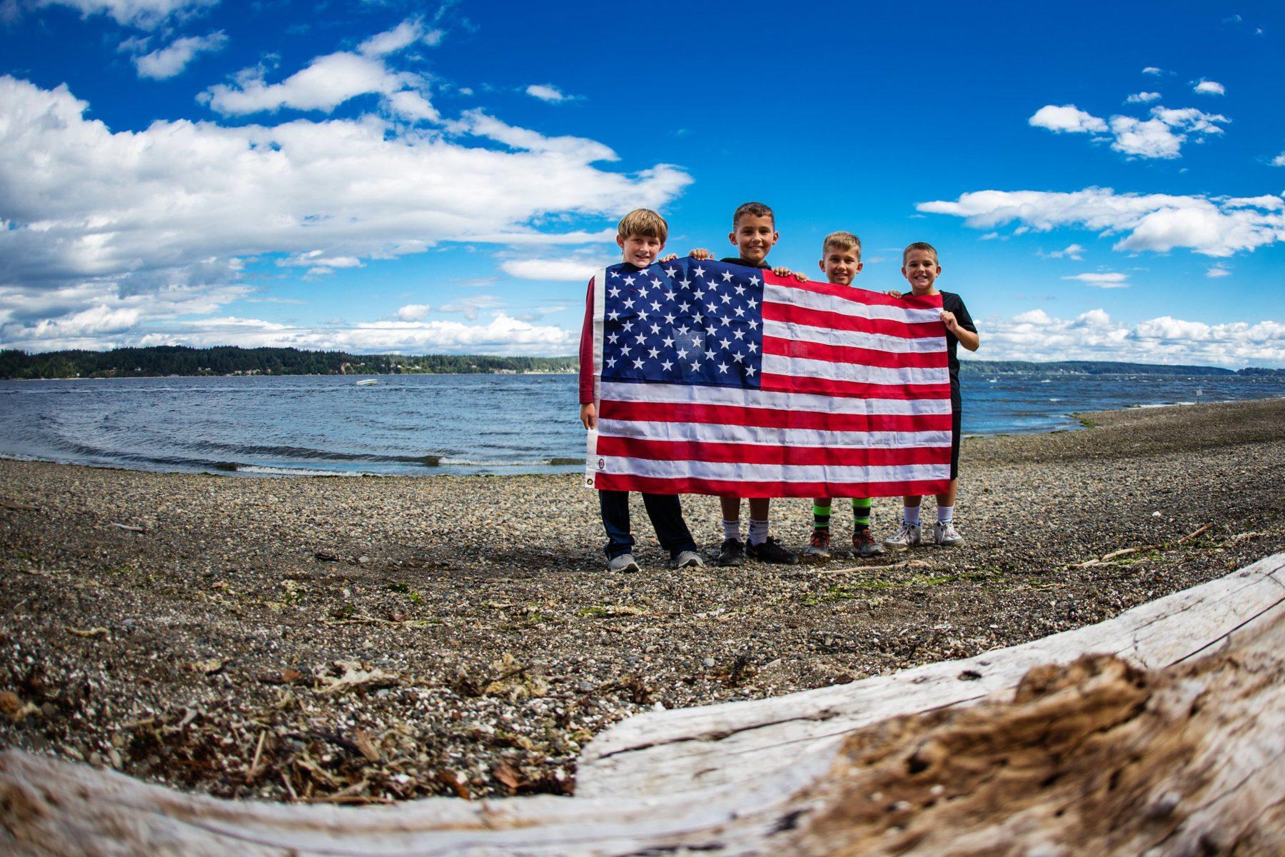 boys on beach with American Flag